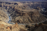 Admire the views of Hells Bend in Fish River Canyon walk the 4 day hike along the canyon and relax in the hot springs of Ai Ais