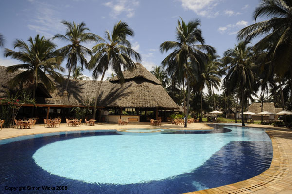 Relax beside the pool or on the beach at Bluebay beach hotel Zanzibar